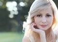 Smiling blonde girl. Portrait of happy beautiful young woman, outdoors. Bokeh Royalty Free Stock Photo
