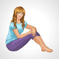 Smiling blonde girl sitting on the floor Royalty Free Stock Photo