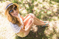 Smiling blonde relaxing in the grass on a sunny day Stock Photography