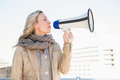 Smiling blonde speaking on megaphone Royalty Free Stock Photo