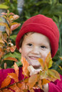 Smiling boy and autumn leaves Royalty Free Stock Photo