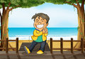 A smiling boy and a beach illustration of standing on wooden platform on Royalty Free Stock Photo