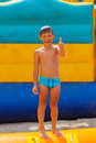 Smiling boy on blue swimming trunks during his summer vacation Stock Photography