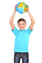 Smiling boy in casual holding globe in hands above his head isolated on white Royalty Free Stock Photography