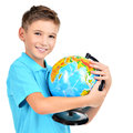 Smiling boy in casual holding globe in hands isolated on white Royalty Free Stock Images