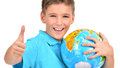 Smiling boy in casual holding globe with thumbs up sign isolated on white Royalty Free Stock Photos