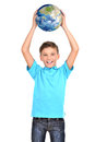 Smiling boy in casual holding planet earth in hands above his h head isolated on white Stock Image