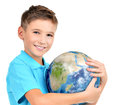 Smiling boy in casual holding planet earth in hands isolated on white Stock Image