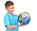 Smiling boy in casual holding planet earth in hands and looks on it isolated on white Royalty Free Stock Photos