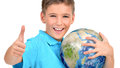 Smiling boy in casual holding planet earth with thumbs up sign isolated on white Stock Photos