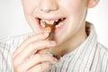 Smiling boy eating milk chocolate bar close up Royalty Free Stock Photo