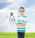 Smiling boy in eyeglasses with white blank board Royalty Free Stock Photo