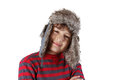 Smiling boy in furry hat on white background Stock Photos