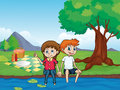 A smiling boy, a girl and a river Royalty Free Stock Photo
