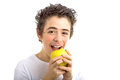 Smiling boy going to bite  a yellow apple Royalty Free Stock Photo