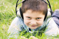 Smiling boy in headphones outdoors Stock Image