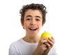 Smiling boy holding a yellow apple Royalty Free Stock Photo