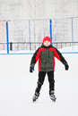 Smiling boy on the ice rink standing outdoors Royalty Free Stock Image
