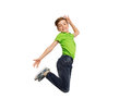 Smiling boy jumping in air Royalty Free Stock Photo