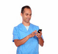 Smiling boy nurse sending message on cellphone portrait of a isolated background Royalty Free Stock Image