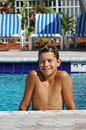 Smiling boy  in the pool Royalty Free Stock Photos