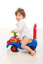 Smiling boy ride a big car toy toddler riding and looking camera Stock Photos