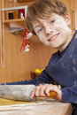 Smiling boy rolling dough Royalty Free Stock Image