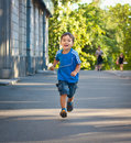 Smiling boy running with ice cream Royalty Free Stock Image