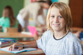 Smiling boy at school primary student sitting in his classroom Royalty Free Stock Photography