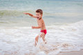 Smiling boy on the sea Royalty Free Stock Photo