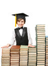 Smiling boy at stacks of old books Royalty Free Stock Photo