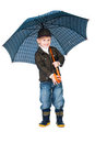 Smiling boy standing under umbrella isolated Royalty Free Stock Image
