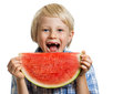 Smiling boy taking bite of water melon a happy about to take a juicy slice watermelon isolated on white Stock Photography