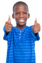 Smiling boy with thumbs up on a white background Royalty Free Stock Photo