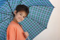 A smiling boy with an umbrella Royalty Free Stock Photo