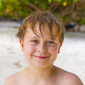 Smiling boy with wet hair at the beach Royalty Free Stock Photo
