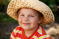 Smiling boy in a wicker hat Royalty Free Stock Photo