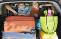 Smiling boys in loaded car portrait of young Royalty Free Stock Photo
