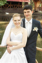 Smiling bride and groom outdoors Royalty Free Stock Photo