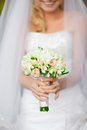 Smiling Bride holding a bridal bouquet Royalty Free Stock Images