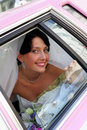 Smiling bride in limousine Stock Photography