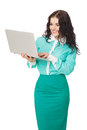 Smiling brunette girl in green skirt and blouse holding laptop slim beautiful over white background Royalty Free Stock Photo