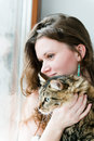 Smiling brunette girl and her cat over beautiful ginger Stock Photos