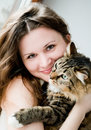 Smiling brunette girl and her cat over beautiful ginger Stock Photo