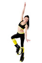 Smiling brunette girl with long hair training in a kangoo jumps Royalty Free Stock Photo