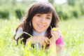 Smiling brunette in grass with dandelion Stock Images