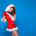 Smiling brunette lady posing happy woman wearing santa claus costume looking at camera Stock Image