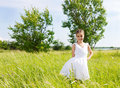 Smiling brunette little girl on medow Royalty Free Stock Photo