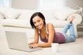 Smiling brunette using laptop Royalty Free Stock Photo