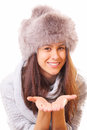 Smiling brunette woman in a fur hat Stock Image